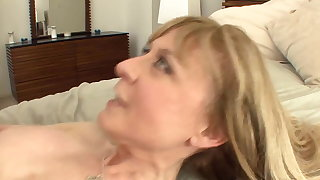 Busty cougar seduces in stockings with the addition of a garter