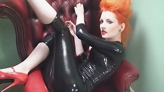 Leather fetish redhead babe Ulorin Vex takes off her tight shirt