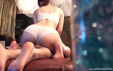 Adorable Asian girl gets the brush pussy massaged to a big fat dick