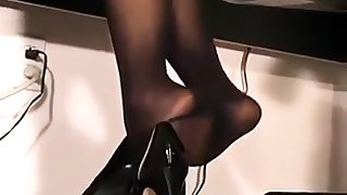 Gorgeous petite secretary working in black pantyhose