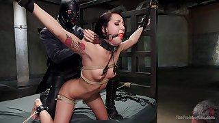 Gagged babe endures anal in a rough BDSM cam play