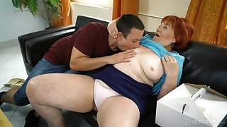 Mature redhead Marsha enjoys dealings helter-skelter a younger lover